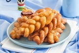 Koeksisters are a sticky, crunchy donut sweet treat that is popular across South Africa. More specifically, they have a crunchy outside crust with a sticky, almost liquid syrup sensation in the centre.  https://www.biltongplus.co.nz/koeksisters/