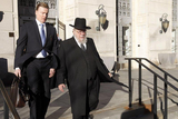 Robert G. Stahl leaving courthouse with client