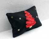 Black, red and gold Christmas tree cushion