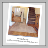 This entrance way has that added touch of luxury with a made to measure rug using the same carpet as the stairs. The rug curves around the stairs to give a chic design finish.