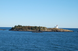 Pea Point island and lighthouse from the water