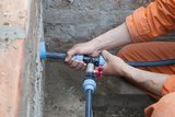 plumber installs water pipes