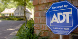 An ADT Security sign sits out in front of a home in Sandy Springs, GA on May 11, 2007. Photographer: Chris Rank/ Bloomberg News