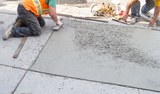 Laying down new pavement in residential neighborhood