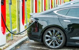 Electric Cars Battery Charging Station. Modern Transportation Technologies.