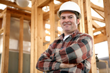 A handsome, friendly construction worker on the job site.  Authentic construction worker on actual construction site.