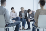 Psychotherapist supporting man who lost his wife. Support group meeting for people in mourning