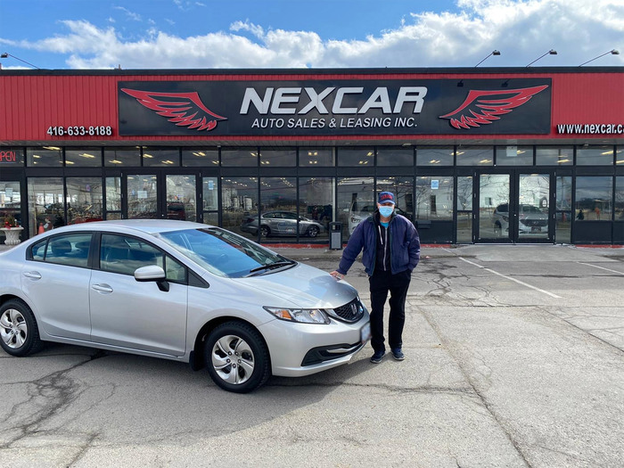 Sold! 2015 Honda Civic LX to our happy client!  Happy Client Photo 2 of Nexcar Auto Sales & Leasing 1235 Finch Ave W - Photo 30 of 41